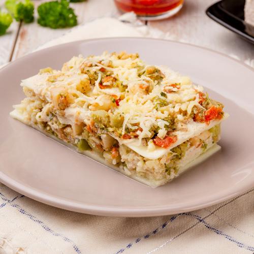 Lasanha fit de pupunha, tomate seco e brócolis